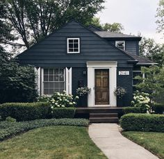 Dark blue siding with beautiful wooden door