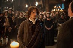 Jamie stands before Colum and declares his loyalty to the clan — but keeps his name.