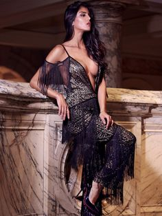 Our  Alcidea  deep V plunge lace fringed jumpsuit is an extravagant party  piece that 274660c75