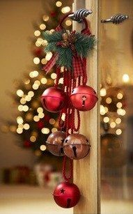 Jingle bells on the door knob, so Santa's elves can at least have a warning that the kids are popping in while gifts are being wrapped! Quick, throw a cover over everything!! #HolidayDecor
