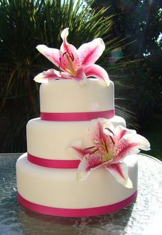3 tiered wedding cake with oriental lillies by cupkatesuk, via Flickr