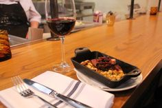 Hot off the grill—beans and pulled pork at Agricola Street Brasserie.@agricolastreet
