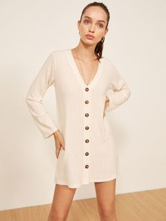 Look cute, be comfortable. This is a long sleeeve, mini length dress with non-functional center front buttons.