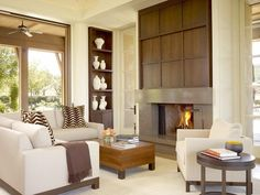 Contemporary fireplace with millwork feature wall.
