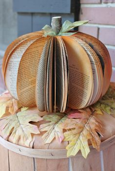 These are cute! Beautiful fall and halloween decor — pumpkin made from upcycled book pages!