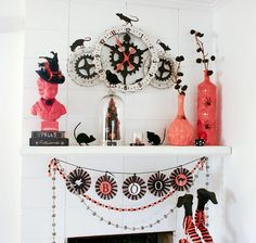 My Halloween mantel with orange and black decorations.