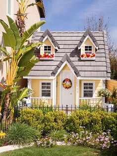 Bring extra fun to your backyard with an outdoor playhouse. These amazingly inventive children's playhouses are inspiring to the young (and the young at heart) and can be counted on for creating hours of backyard fun and plenty of memories. Yellow Cottage, Cozy Cottage, Cottage Style, Backyard Playhouse, Build A Playhouse, Playhouse Kits, Simple Playhouse, Outdoor Playhouses, Girls Playhouse