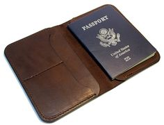 Hand made leather passport wallet  When traveling,protect your passport and carry your cards, cash, and other paper work all in this sleek stylish wallet. Fits into most back pants pockets  Made from walnut colored bridle leather.  Sewn with industrial bonded poly thread  One pocket for passport, one pocket for cash and paper work, 2 card slots can hold 3 cards each.  Approx closed dimensions 4.25 wide x 5.75 tall (10.8cm x14.6cm)  Can be personalized with up to 4 1/4 letters as seen in the…