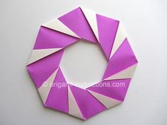 Origami modular candy cane wreath. Photo diagrams for folding the units, and a video for assembly.