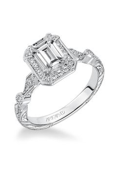 "Brides.com: . Style V634, ""Georgina"" vintage-inspired prong-set halo engagement ring with hand engraved and milgrain details, $1,500 (for setting only), ArtCarved"