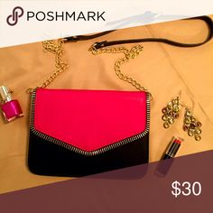 Small pink/black purse Urban Expressions brand raspberry/black clutch with gold chain and leather strap. Zipper detailing on front. Inside has one zipper pocket and one open pocket. Magnetic clasp. Urban Expressions Bags
