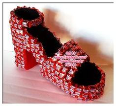 What lady wouldn't love this high heel red bottom chocolate shoe? This is created from Red Snickers and will definitely satisfy your sweet tooth and shoe love with one gift! ***This is a seasonal item available around first of the year*** Candy Birthday Cakes, Candy Cakes, Hershey Chocolate, Chocolate Gifts, Chocolate Pack, Individually Wrapped Candy, Chocolate Flowers Bouquet, Candy Arrangements, Candy Art