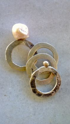 Hand crafted rings by Maria Vasiliou from 925 silver and pearls.