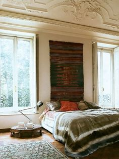 Interesting contrast - boho bedroom in classical architecture