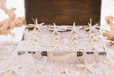 Starfish as seating card alternative- adorable beach wedding idea! Photo by Chris Glenn via june.bg/1ogPey1