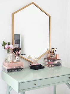 Accessorize your accessories with this to-die-for beauty vanity setup. Coffee table + geometric mirror = makeup organization envy.