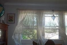 Breeze coming in the windows and blowing the curtains, Love it.