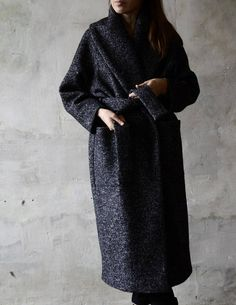 Handmade outerwear clothes by D A L E K O - conciseness, naturalness, simplicity and attention to details. WOMENS WOOL COAT Autumn / Winter 2018 Collection Limited Edition Free and strong silhouette. Black and white patterns - contrasts game always makes a strong impression. Spacious coat