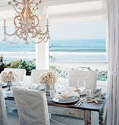Shabby chic beach cottage and of course a chandelier!  Why don't I own one yet???