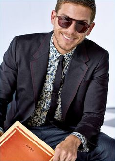 All smiles, Adam Senn dons a suit from Dolce & Gabbana's spring-summer 2017 Sartoria collection.