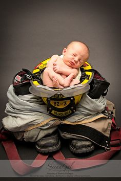 A little fireman in the making! | Newborn Firefighter | Newborn Photography Ideas