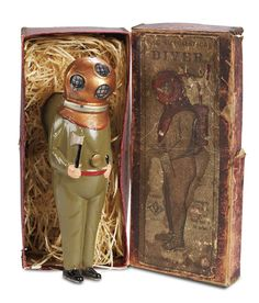 """8"""" German cast metal Diver by Bing, circa 1910. When his extra-strong clockwork is wound,he dives and then arises automatically as the propeller changes the direction of rotation. Extremely rare. Original box."""