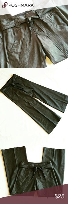 High Waisted Wide Leg Trousers High Waisted Wide Leg Trousers in a dark Greyish Black. They have a zippered and buttoned closure with a self tie belt. Nice wide legs and side pockets. All items are clean fresh and ready to wear. Comes from a smoke free pet free home so buy with confidence. Bundle to save! Pants Wide Leg