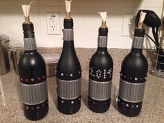 Made my own wine bottle tiki torches for New Years Eve!