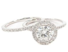 love this super simple diamond engagement ring and thin wedding band.