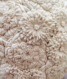 Merging botanical forms from England with the delicate plant shapes from her childhood in Japan, ceramic artist Hitomi Hosono produces delicate layered sculptures that appear as frozen floral arrangements. Often monochromatic, the works are focused o Textiles, Hitomi Hosono, Fashion Design Inspiration, Colossal Art, Paperclay, Fabric Manipulation, Ceramic Artists, Textile Art, Textile Texture