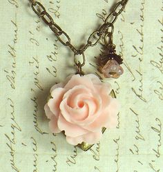 Pale pink roses and lockets - a quaint combination.