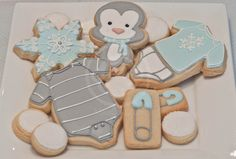 Baby penguin cookies         By MissCuitpinguin, Blue, grey, white, snowflake, diaper pin, onsie