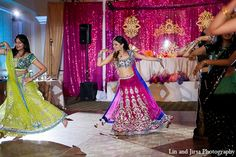 An Indian bride and groom wed in an outdoor Hindu ceremony. The bride and groom choose a pink palette for their wedding and add a touch of blue for their reception.