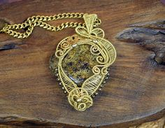 Brass wire wrapped pendant with Bronzite in a Steampunk style. By Jewelled Alchemy  https://www.etsy.com/au/listing/397907683/steampunk-brass-wire-wrapped-pendant