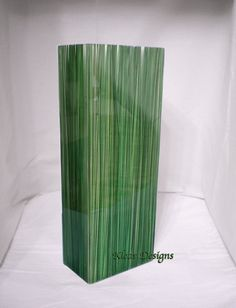 Acrylic vase, made by hand, embedded natural Amazon Grass. $179.00