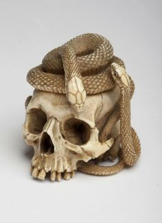 aleyma:  Netsuke skull with snakes, made in Japan in the 19th century (source).