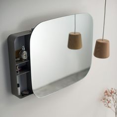 Designed By Michael Hilgers, The Ray Mirror Hides An Invisible Sliding  Mechanism That Turns It
