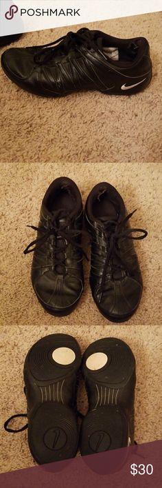 Black Women's Nike Sneakers 8.5 Black Women's size 8.5 Nike brand sneakers. All black with white symbol. Wear/holes inside back at heels. Nike Shoes Sneakers