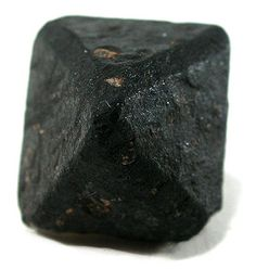 This looks like charcoal, but is actually an uncut black diamond from Sierra Leone.  Gem-quality black diamonds are rare; they are mainly used in industry because of their ability to cut the hardest materials.