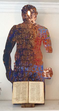 Found sculpture with Muslim prayer book from Ethiopia.By Rick Farrell.