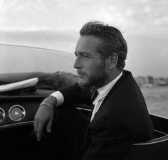 Fifty is King classic -- What is it about the 50 cool set and cars? Actor Paul Newman love for cars is legendary having even participated in actual car racing events well into middle age. Here he is in a reflective moment, wearing an elegant black suit and in one of those fast machines.