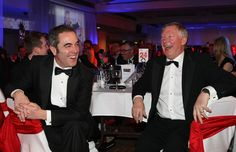 Actor and @manutd fanatic James Nesbitt enjoys a joke with Sir Alex Ferguson during the United for Unicef Ball and Charity Auction at Old Trafford in 2010.