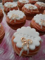 """Celebration with mini cupcakes with golden bows. they say """"hoezee"""" an old word for hurray!"""