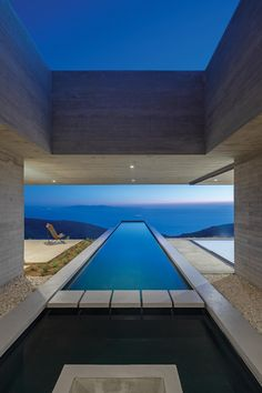 A Long Thin Swimming Pool Extends Out From This Hillside Home Dallas, Langer Pool, Tinos Greece, Architecture Design, Concrete Architecture, Residential Architecture, Rectangular Pool, Exposed Concrete, Concrete Structure