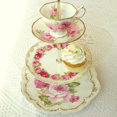 The ever-popular Royal Albert American Beauty cup and saucer top this tiered cupcake and tea stand in pink & red roses.