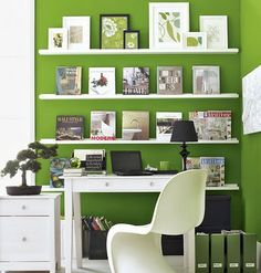 Bold use of color with white shelves makes for a great focal point.