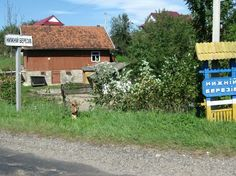 Town signs (translates to Nyzhnii, Bereziv) at the entrance to the village in Ukraine that Gido Genik was from.