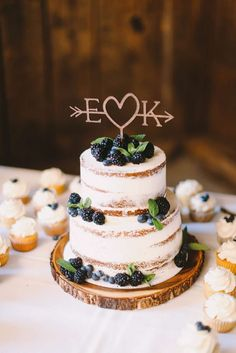 Wedding Cakes Worth Celebrating info@warrenwoodmanor.com Two-tier naked layered wedding cake with laser cut topper and berries #weddingcakes