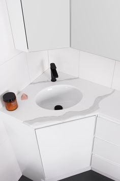 Oval Under-Counter Basin | Architectural Designer Products   Ceramic oval shaped basin in Calacatta Cherry Pie benchtop, with black tapware  Corner vanity unit Corner Vanity Unit, Vanity Units, Shaving Cabinet, White Bathroom Cabinets, Basins, Calacatta, Solid Surface, Counter, Architecture Design