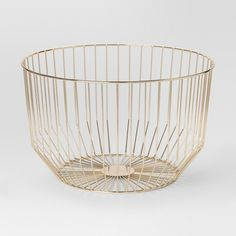 Storage can be hard to come by when you're living in a small place, but with the Round Gold Wire Basket from Project 62™, you can stow your stuff in style without losing out on space. The modern design of this gold storage basket brings simplicity to your home while giving you a functional yet stylish place to keep your things.<br><br>1962 was a big year. Modernist design hit its peak and moved into homes across the country. And in Minnesota, Target was born &mdas...